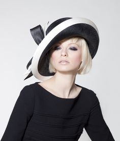 Classic and Chanel-like. Dillon Wallwork - Black parisisal halo brim trimmed with off-white duchesse satin bind and two-tone bow.