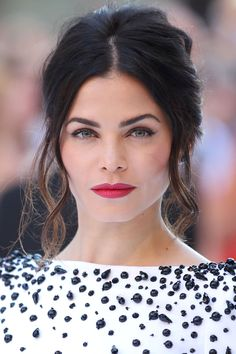 """Jenna Dewan-Tatum Hairstylist Dayaruci gave the actress a """"French-mod updo"""" to show off the embellished neckline on her Zuhair Murad jumpsuit."""