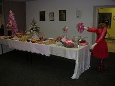 A Valentine buffet featuring a dress form greeter.