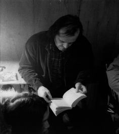 Actor Jack Nicholson reading between takes on the set of The Shining.