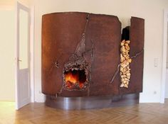 ** Unusual fireplace  I will if you will.  Go full-on industrial rusty metal.