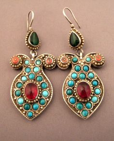 Uzbekistan | Earrings; silver, turquoise, coral, glass and silver gilt | Sold