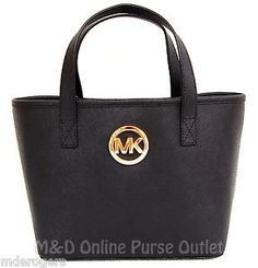 Michael Kors Jet Set Travel Tote Bag Black :-:Over at Gemoutlook.com shoppers may well get the satisfaction of possessing a great quality leather ladies handbag. Sturdy all-natural leather messenger bags a range of benefits.