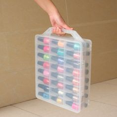 carry-all nail polish container comes with adjustable dividers to fit your polish perfectly.This carry-all nail polish container comes with adjustable dividers to fit your polish perfectly. Nail Polish Holder, Nail Polish Storage, Diy Nail Polish, Clear Nail Polish, Nail Polish Colors, Diy Nails, Organize Nail Polish, Diy Storage Containers, Makeup Containers
