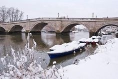 Richmond bridge and boats on the River Thames in Richmond, covered by snow Richmond Upon Thames, Kingston Upon Thames, Richmond Bridge, River Thames, Old London, London Calling, Surrey, Places, Boats