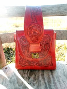 ♥♥reserved♥♥    This is a sweet little purse that is in red. This purse is small and unusual. The purse measures 7x4 and is 7 tall. The outside of