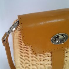 Our handbag is made from 100% natural finest rattan with handwoven technic, modified with cow leather and handsewn. Very limited stock and made to order. If you want to give something unique, try our bag ! Feel the different!!