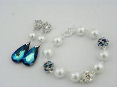 Peacock Wedding Earrings: Bermuda Blue Swarovski, White Pearl, Dark Blue Earrings, Cubic Zirconia, Drop Sterling Silver Post, Bridesmaid. $33.00, via Etsy.