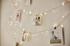 Hanging photos or cards on strands of Christmas lights would be beautifukB