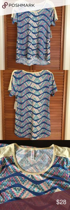 LuLaRoe L Classic T BNWT LuLaRoe Large Classic T, brand new with tags, never been worn. Colors are pretty pastels pink, blue, buttercream, with a dusty denim blue wave. LuLaRoe Tops Tees - Short Sleeve