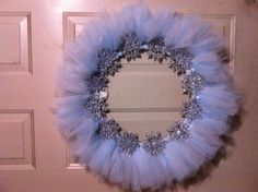Snow flake wreath under $20 made myself. With a wreath circle, 7 yards of tule divided into 2 colors and $1 store snowflake ornaments.