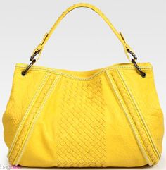 BottegaVeneta Intrecciato Bag  This lovely piece has everything we've come to know and love about this designer. Take a look at that gorgeous weave and those braided accents! This slouchy hobo is perfect for everyday use and would work well with just about any wardrobe.