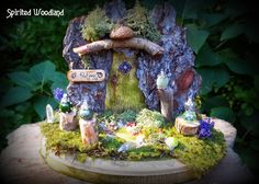 One of a kind magical potion maker Fairy Door featuring lamp-work potions.  Oak bark, reindeer moss, miniature mushrooms and real crystals.  Created by Roxie Zwicker, Spirited Woodland Designs.