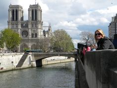 Kim, overlooking the Seine in Paris. And Notre Dame in the background.