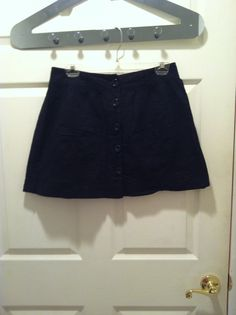 Black button down skirt, size 12 UK (fits like a US medium), has front pockets. Worn but in good condition. Not looking to trade it for much.