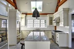 Fresh & modern open kitchen in Laurel Hollow barn home. Visit to see more on this house, including floor plans. #barnhomes