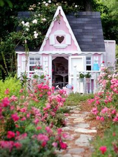 pink cottage with a lovely rose garden