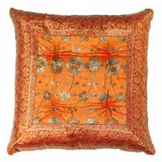 Bring a pop of color to your sofa or favorite arm chair with this chic pillow, showcasing a floral-inspired motif in orange.