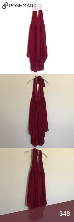 """Nasty Gal burgundy halter backless high low dress Flowy dress with tie back halter. Zip back with open back. Excellent condition new without tags, fully lined. Deep burgundy red color. Waist measures 13"""", skirt length front 25"""", back 30"""". Bundle to save 25%! Nasty Gal Dresses"""