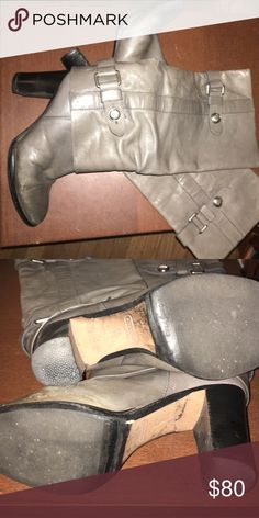 Coach gray knee high heeled boots Coach gray leather knee high heeled boots. Beautiful straps and buttons. Some discoloration around the base of the foot but overall in good used condition. Definitely best for someone with small calves. Coach Shoes Heeled Boots