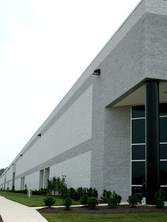 Featuring split face masonry in Arctic White and Mist.