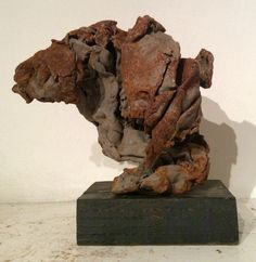 Ready-made art from finely aged scrap metal.by Rick Farrell.