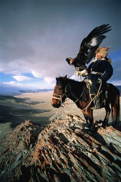 Kazakh eagle hunter - 'berkutchi' - surveying his territory