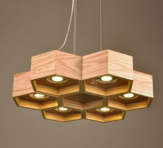 This wooden Chanderlier is beautiful, elegant and simple to assemble. This chandelier is made by combining the hexagonal shaped wooden blocks into a flower structure. The dip-lights inserted in the base gives opportunity for a well-lit room. It is modern, smart and goes with the interior based on geometric shapes.