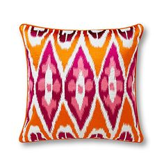 love this colorful ikat pillow {would look great on a beige couch}