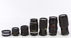 Lot 563: Camera Lens Assortment; Seven lenses produced by Canon or Tou / Five Star; together with a camera bag by Coastar