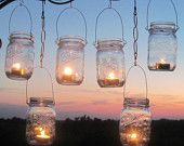 I have a bunch of mason jars, and I have been looking for a way to make lanterns for them for our back porch.  This weekend!