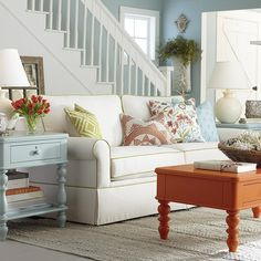 I would've never thought to be so carefree with color! Green chair, orange coffee table, blue end table.