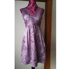 Violet Formal dress purple prom evening size 8 Exquisite formal dress by Adrienna Papell Boutique Size 8 Silky medium lavender material has a slight shine that looks so beautiful in the light. Deep v neck and fitted waist. Flowy skirt has ruffle design. Linked criss cross back. Polyester/nylon/acetate. In like new condition. From a smoke free home.  POSHD8588VIOLET888 Adrianna Papell Dresses Midi