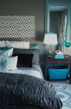 A unique turquoise and gray bedroom with lush bedding and fun patterns and textures by Lindsay Hoekstra West Michigan interior designer.