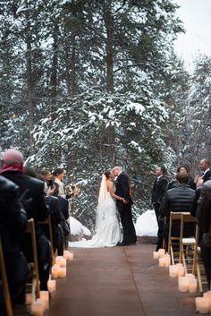 Brinton Studios, winter wonderland wedding, ceremony shot, snowy vows, first kiss, bride and groom, Donovan Pavillion in Vail, folding chairs, candles
