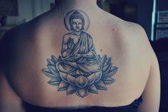 Buddha sitting on lotus tattoo, love this one!