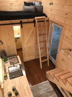 An additional guest loft with ladder access is above the bathroom.