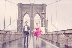 The Brooklyn Bridge, a future bride, groom, pink sweetheart dress, skinny tie and balloons on a cloudy day. From Simply Bloom Photography