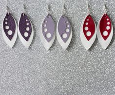 Whithe and pink, lilac or purple leather earrings with spots. The lenght of them is approximately 5 cms. Colours might appear slightly different on the screen than in real life. My creations come from a smoke and pet free environment.