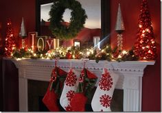 A Christmas Mantle. JOY made out of wooden blocks