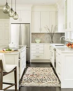 Grey backsplash in a white kitchen--the look may be subtle, but it still has tons of personality. #repost : @jpalumbo_int_design • • •  A pleasant kitchen to cook in for a great client #jenniferpalumboinc #kitcheninspiration