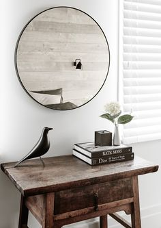 Modern farmhouse style incorporates old and new pieces. Here, a modern round mirror juxtaposes against a rustic antique side table. If you're looking for a more sleek look for shiplap, instead of painting white, you can add bleached wood paneling. Sweet Home, Modern Farmhouse Style, Modern Rustic, Rustic Farmhouse, Round Mirrors, Wall Mirrors, Mirror Mirror, Scandinavian Home, Home And Deco