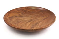 The wood of the black walnut tree is highly valued due to its tendency to avoid trunk bending and produce beautiful graining. This large bowl showcases the prized natural material with a dramatic cont