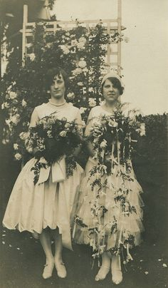1930s. I got the same idea of the bouquet on the right from an old photo, for my wedding.  Such a neat idea that you don't see much of today.