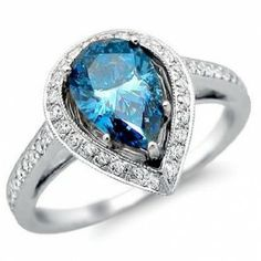 oooooooo blue diamond... pretty! Fancy Blue Pear Diamond Engagement Ring - A huge sparkling gemstone with a beautiful color that will turn heads comes this glistening Fancy Blue Pear Diamond Engagement Ring stamped in 18k White Gold placed in a Pave & Prong setting featuring a large Blue Pear cut center stone with white round cut accent stones on the halo mount & the shank. This gorgeous Fancy Blue Pear engagement ring is an SI1 in clarity & the total weight is 1.88 carats.