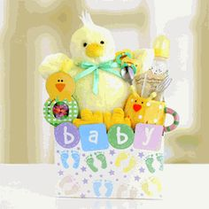 "Tweets for Baby and Mom Gift Box - Send some ""Tweets"" to both the new baby and mom both with this adorable mama and me gift basket of goodies.  A fuzzy yellow chick sits atop our Baby footprint gift box, holding 'egg-zactly' what baby needs in those first few months and special treats for mom! $49.95"