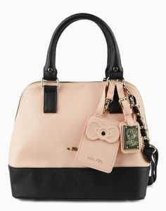 It's Hello Kitty love at first sight with this handbag. An elegant combination of black and apricot crosshatch faux leather with a three-quarter zip and goldtone hardware.