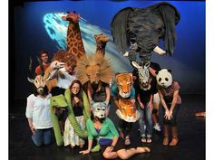 I spent 6 weeks helping high schoolers build 50 animal mask for Children of Eden. this picture made the newspaper.I'm the one wearing the gazelle mask.