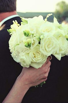 White Roses, White Lisianthus & Buds, White Freesia & Lily Of The Valley Wedding Bouquet
