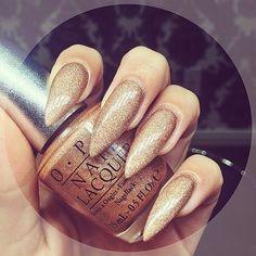 Shimmer gold stiletto nails #laque #laquenailbar #getlaqued by laquenailbar http://ift.tt/1ocM4jG